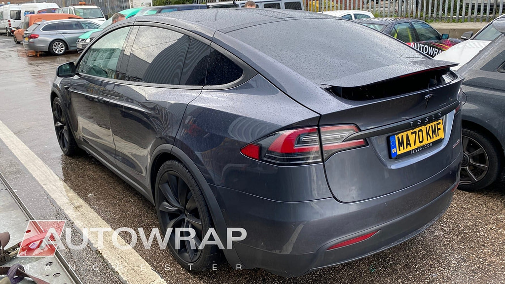 A Tesla with the chrome made black