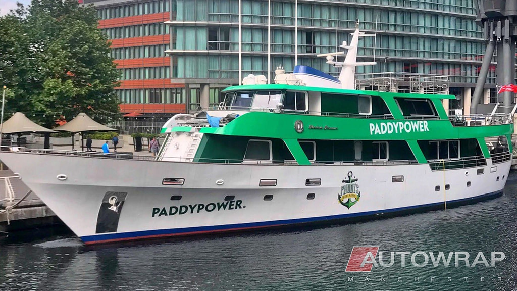 A large boat wrapped in Paddy Power livery