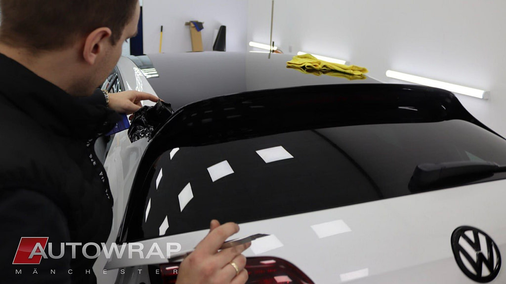 A wrap being applied to a car