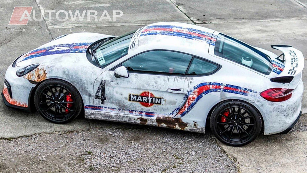 A car with a custom printed Martini wrap, designed to look rusted