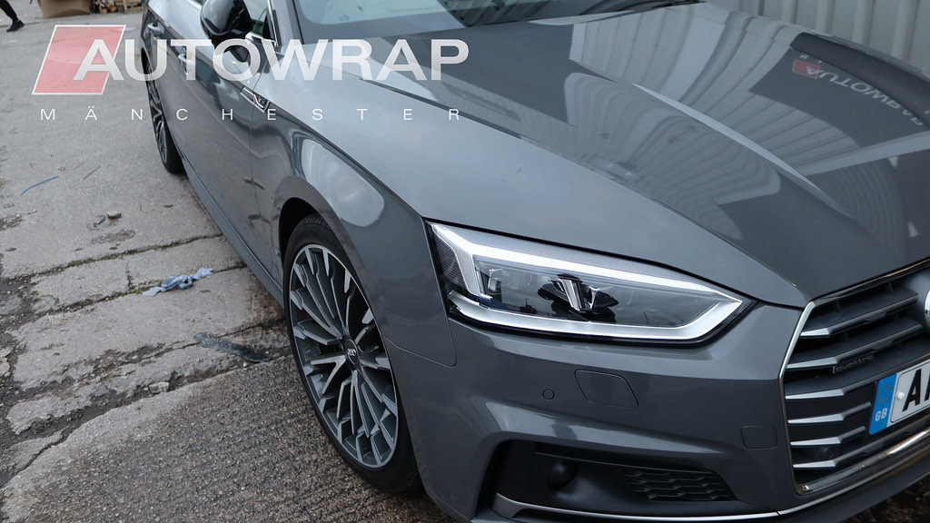An Audi wrapped in a glossy dark grey vinyl