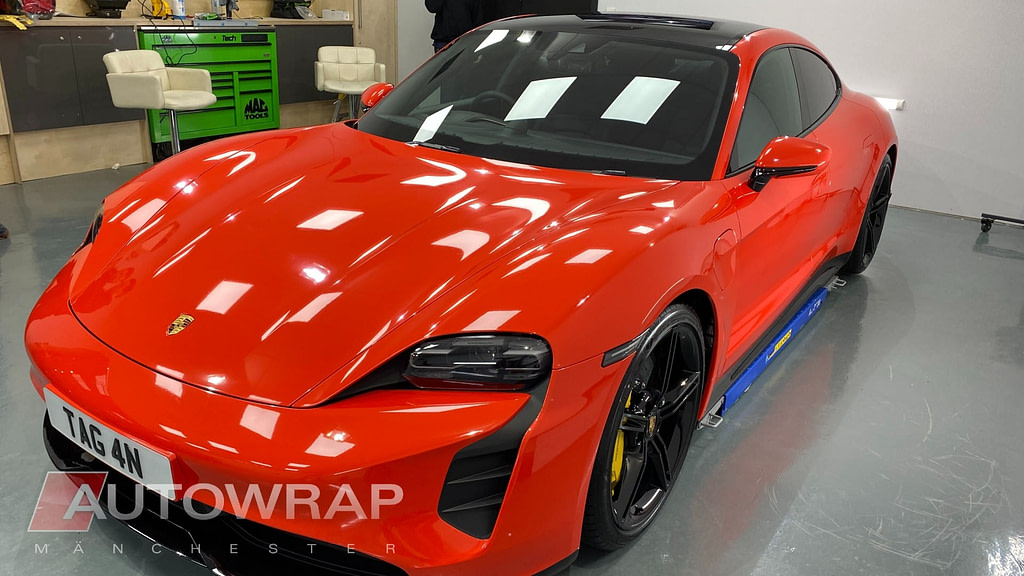 A wrapped red car with a PPF layer