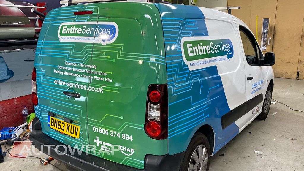 Graphics, lettering and a partial wrap on a van for Entire Services