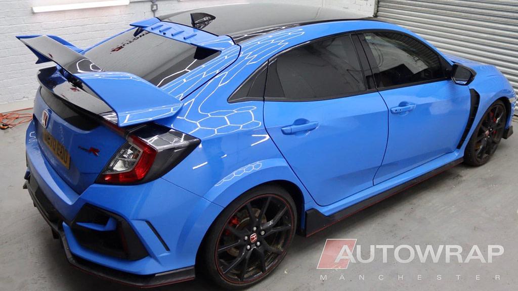 A gloss black roof wrap on a blue car