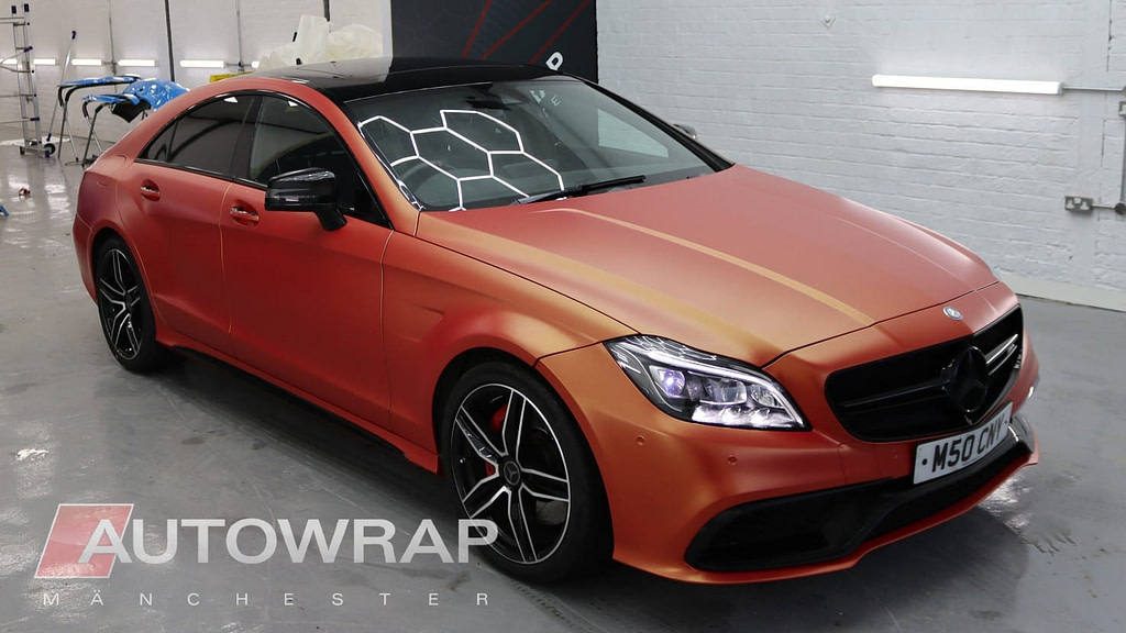A Mercedes CLS with a full vinyl wrap in Sunset Shift, which is a palette of colours in the yellow-orange-red spectrum.