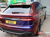 An Audi RSQ7 with a vinyl wrap in 'Roaring Thunder Flow', which is a palette of colours from deep blue/purple, through pink and red to orange.