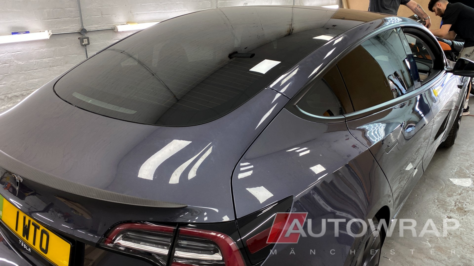 A rear half tint on a tesla model 3. On this car, the rear window comes right over the top of the car in a panoramic roof style.