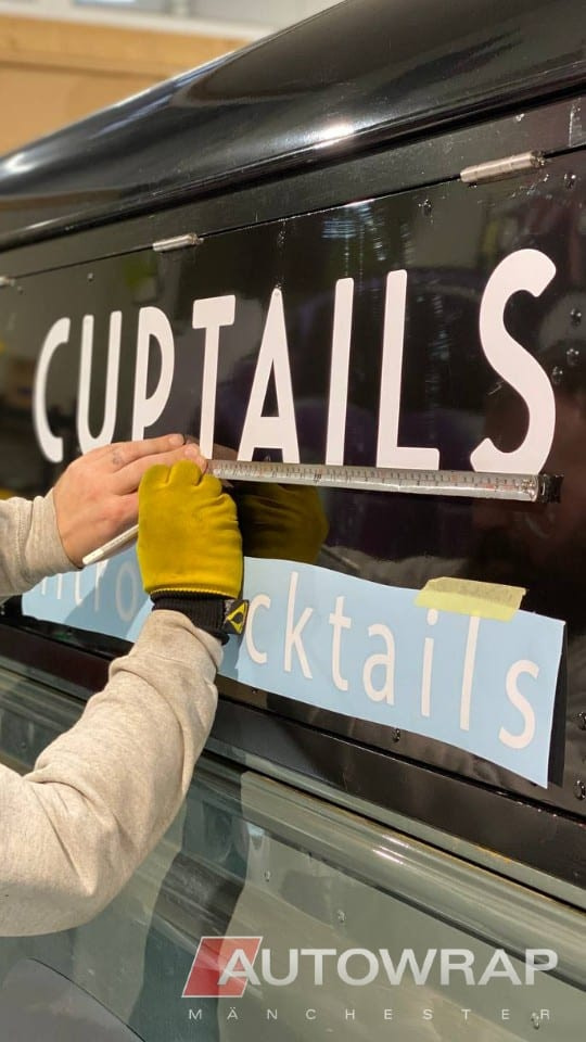 """Signage for """"Cuptails"""" being applied to a commercial vehicle"""
